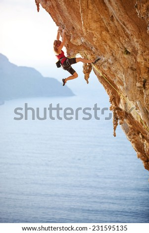 Family rock climber at sunset. Kalymnos Island, Greece.