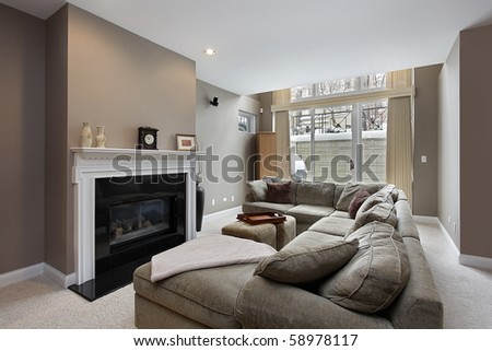 Family room in city condo with black fireplace - stock photo