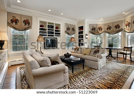 Family room in luxury home with built in cabinets