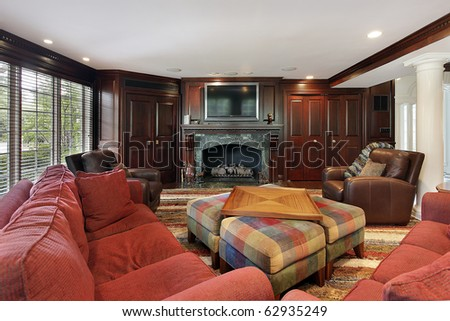 Family room in luxury home with cherry wood cabinetry - stock photo