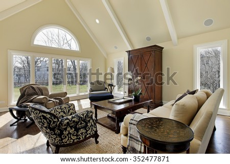 Family room in luxury home with curved window - stock photo