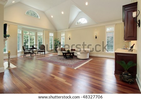 Family room in luxury home with curved windows - stock photo