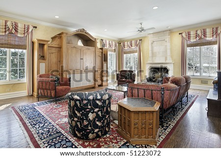 Family room in luxury home with stone fireplace - stock photo