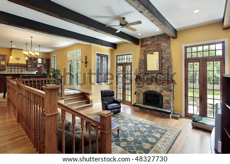 Family room in luxury home with wood ceiling beams - stock photo