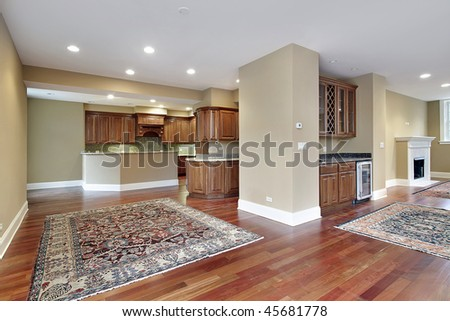 Family room in new construction home with cherry wood floors - stock photo