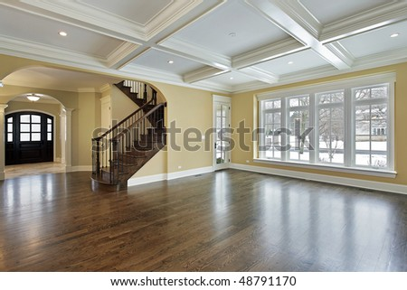 Family room in new construction home with view into foyer - stock photo