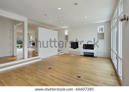 Family room in remodeled home with white cabinetry - stock photo