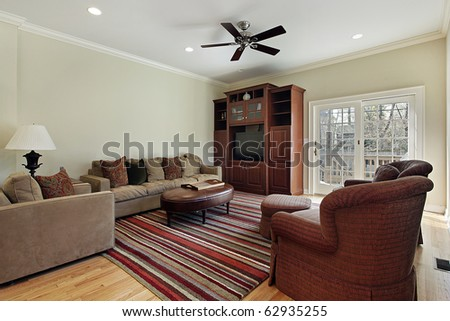 Family room in suburban home with door to deck - stock photo
