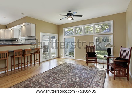 Family room in suburban home with doors to deck - stock photo