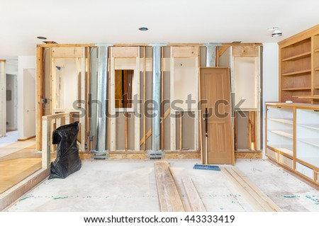 Family room wall openings and pony wall framed. Heating ducts could not be moved - stock photo