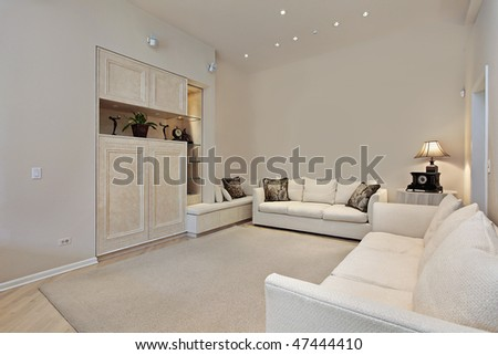 Family room with built-ins in suburban townhouse - stock photo