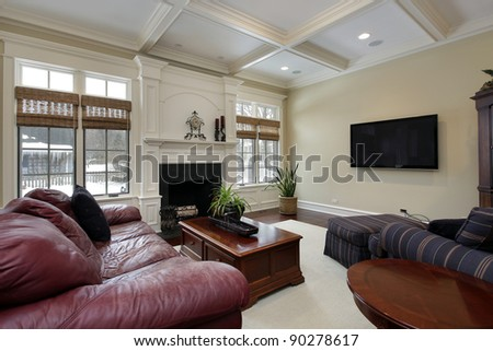 Family room with fireplace and leather couch