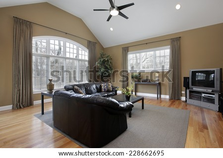 Family room with large picture window and brown walls  - stock photo