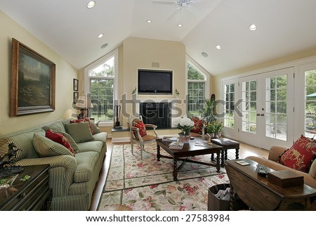 Family room with large picture windows - stock photo