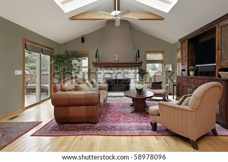 Family room with skylights and white brick fireplace - stock photo