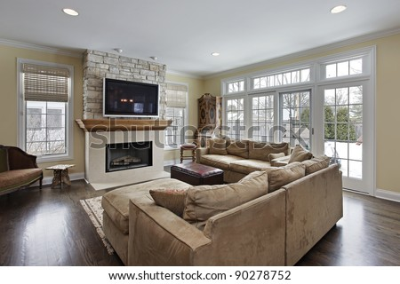 Family room with wood and stone fireplace - stock photo