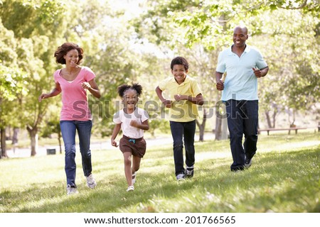 Family running in park - stock photo