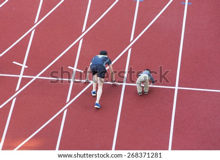 family  running on the track in stadium - stock photo