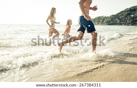 family running out the water in phuket, Thailand. Concept about family, vacation, fun and people - stock photo