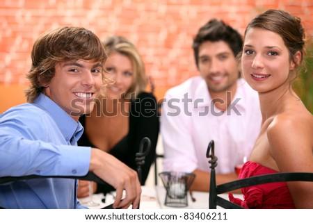 Family sat in restaurant - stock photo