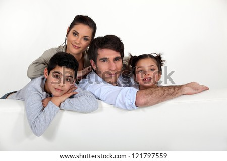 Family sat on couch - stock photo