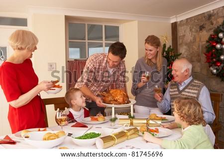 Family serving Christmas dinner - stock photo
