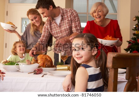 Family serving Christmas dinner - stock photo
