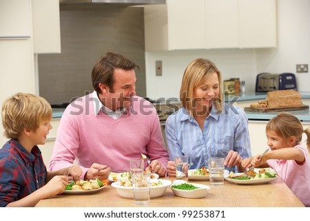 Family sharing meal together at home - stock photo
