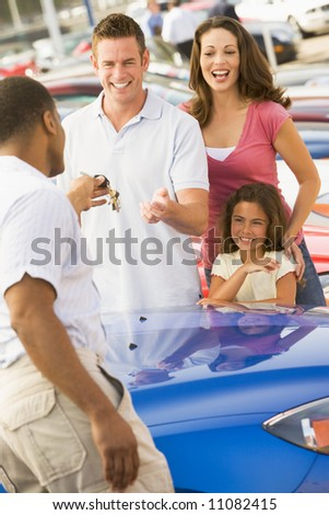 Family shopping for new car - stock photo