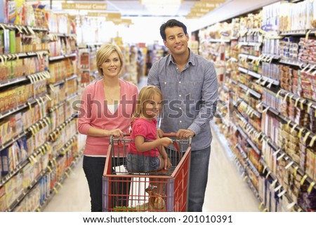 Family shopping in supermarket - stock photo