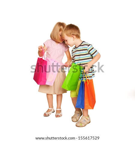 Family shopping. Young couple, little boy and little girl, checking and looking shopping bags. Holiday Sale. Ready for your text, logo or symbols. Isolated on white background. - stock photo