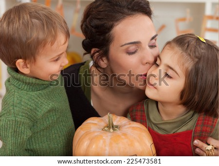 Family showing affection while preparing for autumn holidays - stock photo