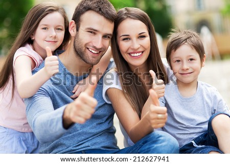 Family showing thumbs up  - stock photo