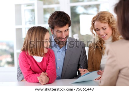 Family signing real-estate contract - stock photo