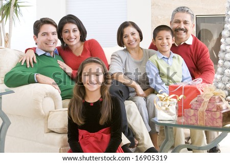 Family Sitting Around A Coffee Table And Christmas Gifts - stock photo