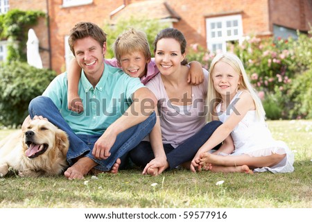 Family Sitting In Garden Together - stock photo