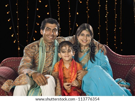 Family sitting on couch and celebrating Diwali festival