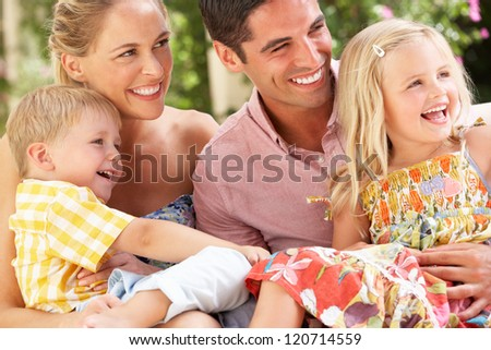 Family Sitting On Sofa Together - stock photo