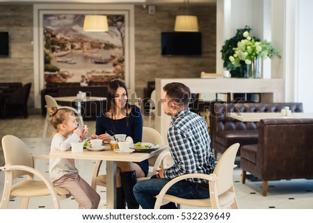 Family sitting together at table in a restaurant