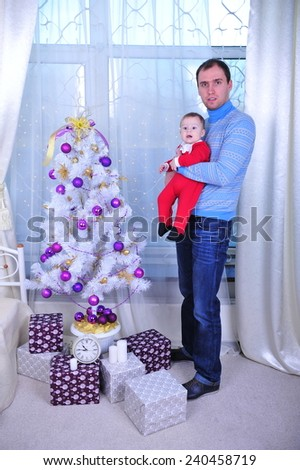 Family sitting together in Christmas interior. Happy family having fun with Christmas presents. Christmas Family Portrait, Mother And Son Celebrate Holiday, Opening Present Gift Box  - stock photo