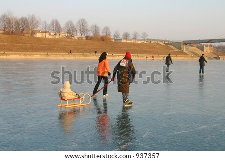 Family skating on ice - stock photo
