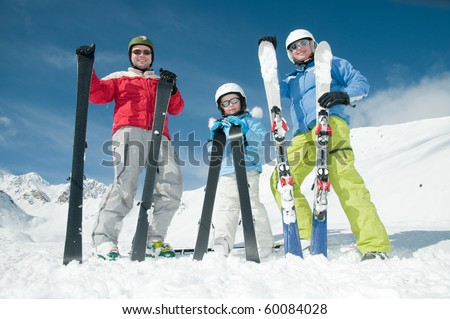 Family, ski, snow and fun - stock photo