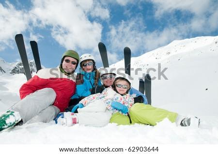Family, ski, snow and fun - stock photo