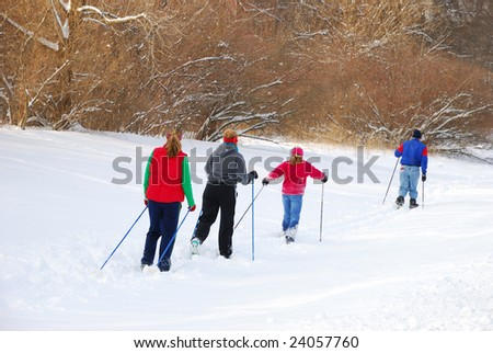 family skiing - stock photo