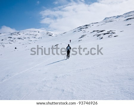 Family skiing up hill in the norwegian mountains at easter