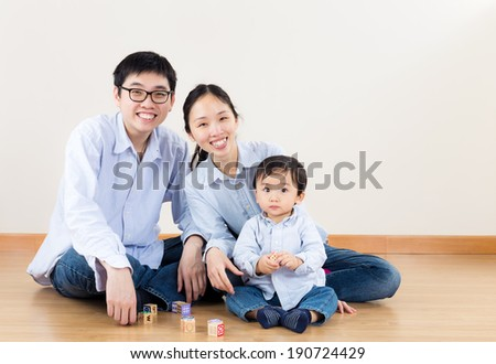Family smiling at home - stock photo