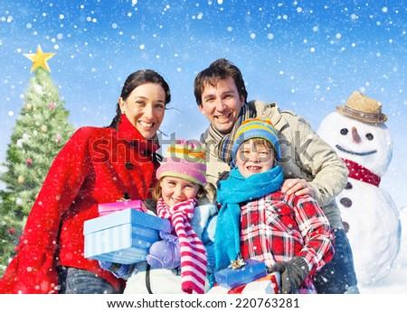 Family spending christmas in the snow - stock photo