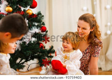 Family spending time near Christmas tree