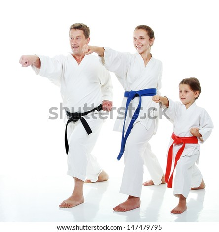 Family sportsmen two sisters with her father in a kimono beat punch arm - stock photo