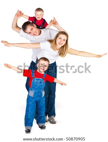 Family spreading out their arms like flying plane